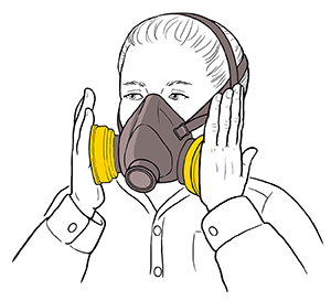 Woman testing fit of half-mask respirator.
